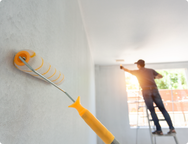 Two People Painting walls and ceilings