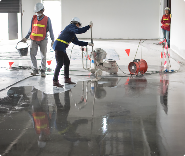 a team of professionals applying an epoxy finish to the floor in a home