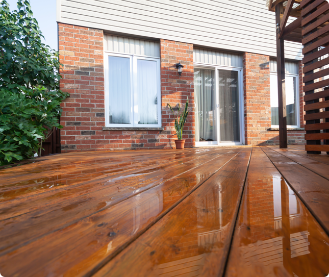 a beautifully finished outdoor deck covered in rain water