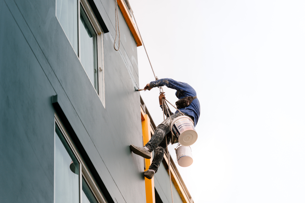 a commercial painting contractor painting the exterior of an office building