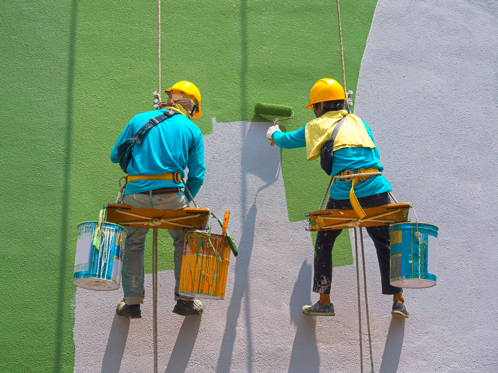 commercial painting contractors painting an office building green